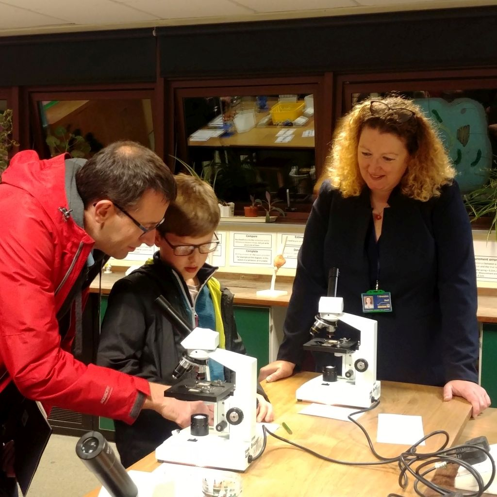 Visitors try out microscopes
