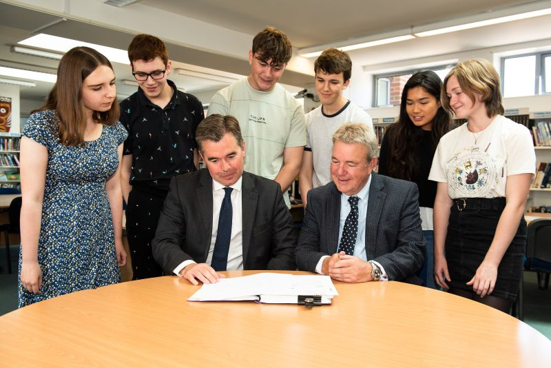 Jon Pebworth (seated right) with the Head and sixth form students in the school library
